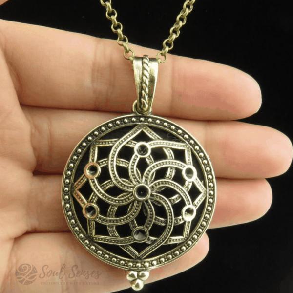 Essential Oil Aromatherapy Diffuser Round Vintage Locket - Bronze Mandala in hand
