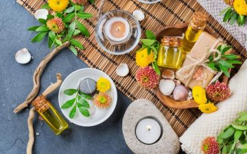 Table with aromatherapy, essential oils, and plant extracts