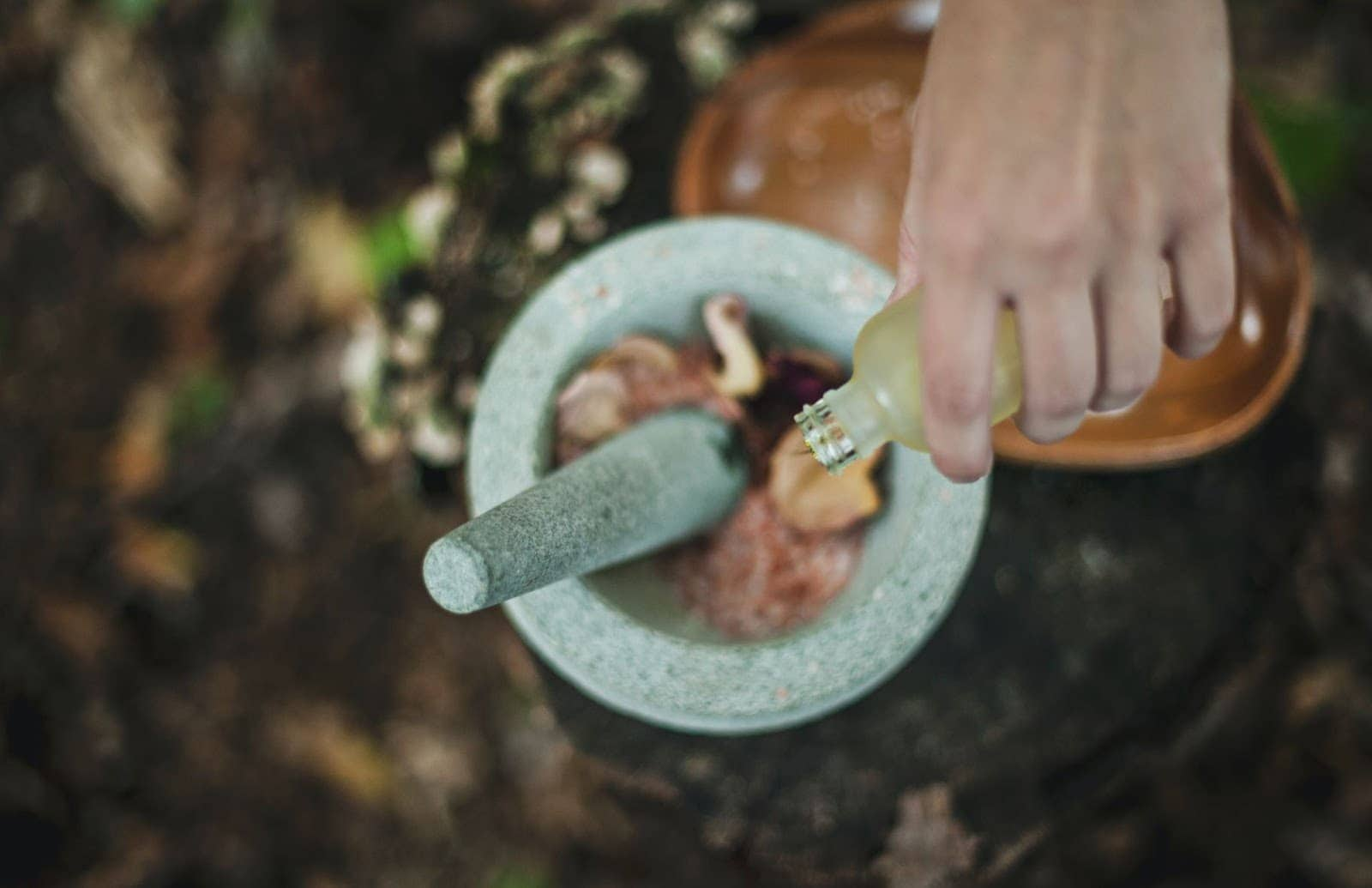 Essential Oil being poured into pestle and mortar
